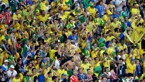 Brazilian fans see the round of 16 match between Brazil and Mexico at the 2018 soccer World Cup in the Samara Arena, in Samara, Russia, Monday, July 2, 2018. (AP Photo/Sergei Grits)