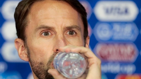 England head coach Gareth Southgate drinks a water during news conference on the eve of the match between Colombia and England at the 2018 soccer World Cup in the Spartak Stadium in Moscow, Russia, Monday, July 2, 2018. (AP Photo/Alexander Zemlianichenko)