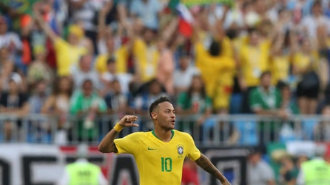 Brazil's Neymar celebrates at the end of the round of 16 match between Brazil and Mexico at the 2018 soccer World Cup in the Samara Arena, in Samara, Russia, Monday, July 2, 2018. Neymar scored once in Brazil's 2-0 victory. (AP Photo/Thanassis Stavrakis)