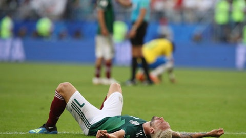Mexico's Miguel Layun lies on the ground at the end of the round of 16 match between Brazil and Mexico at the 2018 soccer World Cup in the Samara Arena, in Samara, Russia, Monday, July 2, 2018. Brazil defeated Mexico 2-0. (AP Photo/Thanassis Stavrakis)