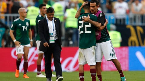 Mexico's Rafael Marquez, right, hugs team mate Hirving Lozano after the round of 16 match between Brazil and Mexico at the 2018 soccer World Cup in the Samara Arena, in Samara, Russia, Monday, July 2, 2018. (AP Photo/Frank Augstein)
