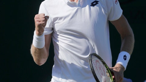 Kevin Anderson of South Africa celebrates winning a point from Norbert Gombos of Slovakia during the Men's Singles first round match at the Wimbledon Tennis Championships in London, Monday July 2, 2018. (AP Photo/Ben Curtis)