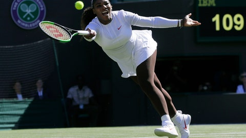 Serena Williams of the US plays a return to Arantxa Rus of the Netherlands during the women's singles first round match at the Wimbledon Tennis Championships in London, Monday July 2, 2018. (AP Photo/Kirsty Wigglesworth)