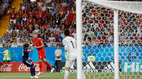 Belgium's Jan Vertonghen, second left, heads the ball to score during the round of 16 match between Belgium and Japan at the 2018 soccer World Cup in the Rostov Arena, in Rostov-on-Don, Russia, Monday, July 2, 2018. (AP Photo/Rebecca Blackwell)