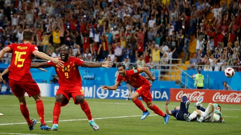 Belgium's Nacer Chadli, second right, celebrates after scoring his third side's goal during the round of 16 match between Belgium and Japan at the 2018 soccer World Cup in the Rostov Arena, in Rostov-on-Don, Russia, Monday, July 2, 2018. (AP Photo/Rebecca Blackwell)