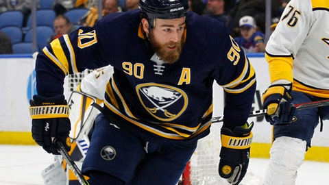 FILE - In this March 19, 2018 file photo, Buffalo Sabres forward Ryan O'Reilly (90) skates during the third period of an NHL hockey game against the Nashville Predators in Buffalo, N.Y. OReilly feels a spark after the Blues acquired him in a trade with the Sabres. The 27-year-old center lamented losing his love for the game after a third consecutive losing season and says hes excited about the move. Going from the expectation of being the man in Buffalo to joining an established core in St. Louis should help OReilly. (AP Photo/Jeffrey T. Barnes, file)