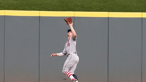 Chicago White Sox center fielder Adam Engel (15) fields a fly ball off the bat of Cincinnati Reds second baseman Jose Peraza during the fourth inning of a baseball game, Monday, July 2, 2018, in Cincinnati. (AP Photo/Gary Landers)