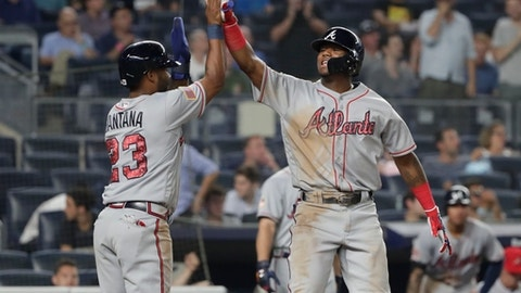 Atlanta Braves' Danny Santana (23) celebrates with teammate Ronald Acuna Jr. after they scored when Acuna hit a two-run home run during the eleventh inning of a baseball game against the New York Yankees Monday, July 2, 2018, in New York. (AP Photo/Frank Franklin II)