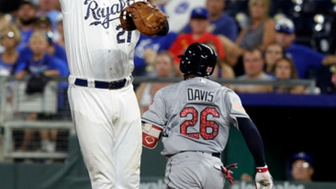Cleveland Indians' Rajai Davis (26) beats out an infield hit past Kansas City Royals first baseman Lucas Duda (21) during the eighth inning of a baseball game at Kauffman Stadium in Kansas City, Mo., Monday, July 2, 2018. The Indians defeated the Royals 9-3. (AP Photo/Orlin Wagner)