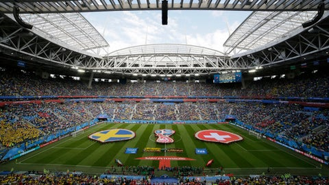 Sweden, left, and Switzerland players listen for the national anthems prior to the start of the round of 16 match between Switzerland and Sweden at the 2018 soccer World Cup in the St. Petersburg Stadium, in St. Petersburg, Russia, Tuesday, July 3, 2018. (AP Photo/Dmitri Lovetsky)