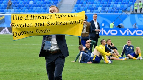 Sweden's Sebastian Larsson holds a banner to fans after winning the round of 16 match between Switzerland and Sweden at the 2018 soccer World Cup in the St. Petersburg Stadium, in St. Petersburg, Russia, Tuesday, July 3, 2018. (AP Photo/Martin Meissner)