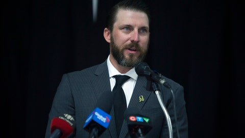 Former NHL hockey player Nathan Oystrick speaks at a press conference in Humboldt, Saskatchewan, Tuesday, July 3, 2018. Oystrick was named the new head coach of the Humboldt Broncos junior hockey team. Oystrick says he's looking forward to leading the team, while never forgetting the tragic circumstances that brought him to the role. The Broncos' team bus collided with a semi-truck at a rural Saskatchewan intersection in April, killing 16 people and injuring 13. Head coach Darcy Haugan died in the crash. (Kayle Neis/The Canadian Press via AP)
