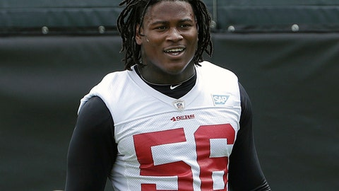 FILE - In this May 30, 2018, file photo, San Francisco 49ers linebacker Reuben Foster walks on the field during a practice at the team's NFL football training facility in Santa Clara, Calif. 49ers linebacker Reuben Foster has been suspended without pay for the first two games of the regular season for violating the NFL's conduct and substance abuse policy. The NFL said Tuesday, July 3, 2018, that Foster will also be fined for violations from a weapons offense and misdemeanor drug charge that were resolved earlier this offseason. (AP Photo/Jeff Chiu, File)