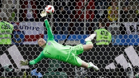 England goalkeeper Jordan Pickford saves a penalty during the round of 16 match between Colombia and England at the 2018 soccer World Cup in the Spartak Stadium, in Moscow, Russia, Tuesday, July 3, 2018. (AP Photo/Matthias Schrader)