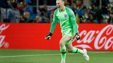 England goalkeeper Jordan Pickford celebrates during a penalty shoot out during the round of 16 match between Colombia and England at the 2018 soccer World Cup in the Spartak Stadium, in Moscow, Russia, Tuesday, July 3, 2018. England won after a penalty shoot out. (AP Photo/Victor R. Caivano)