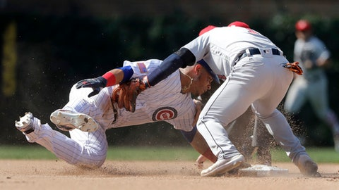 Detroit Tigers shortstop Jose Iglesias tags out Chicago Cubs' Willson Contreras at second as Contreras tried to stretch his single to a double during the eighth inning of a baseball game Tuesday, July 3, 2018, in Chicago. (AP Photo/Charles Rex Arbogast)