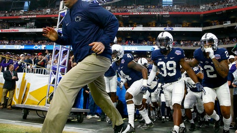 FILE - In this Dec. 30, 2017, file photo, Penn State head coach James Franklin takes the field with his team prior to the Fiesta Bowl NCAA college football game against Washington, in Glendale, Ariz. College football as a public entity cant institute a Rooney Rule like the NFL to compel programs to interview minority candidates for head coaching jobs. Minorities make up only 19 percent of Division I head football coaches and less across the Power Five conferences: the ACC, SEC, Big Ten, Big 12 and Pac 12.(AP Photo/Ross D. Franklin, File)