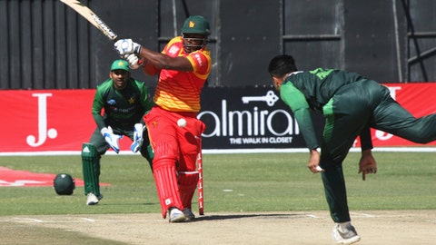 Zimbabwean batsman Cephas Zhuwawo, centre, plays a shot during the T20 cricket match against Pakistan at Harare Sports Club, in Harare, Zimbabwe, Wednesday, July, 4, 2018. Zimbabwe is playing host to a tri-nation Twenty20 International series with Australia and Pakistan. (AP Photo/Tsvangirayi Mukwazhi)