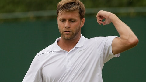 Ryan Harrison of the US prepares to serve during the men's singles match against Adrian Mannarino of France on the third day at the Wimbledon Tennis Championships in London, Wednesday July 4, 2018. (AP Photo/Tim Ireland)