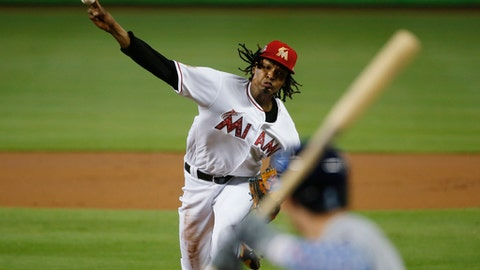 Miami Marlins' Jose Urena delivers a pitch to Tampa Bay Rays' Jake Bauers during the first inning of a baseball game, Wednesday, July 4, 2018, in Miami. (AP Photo/Wilfredo Lee)