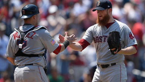 Boston Red Sox relief pitcher Craig Kimbrel, right, celebrates with catcher Christian Vazquez after a baseball game against the Washington Nationals, Wednesday, July 4, 2018, in Washington. The Red Sox won 3-0. (AP Photo/Nick Wass)
