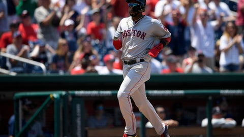 Boston Red Sox' Eduardo Nunez runs towards home to score on a double by Jackie Bradley Jr. during the ninth inning of a baseball game against the Washington Nationals, Wednesday, July 4, 2018, in Washington. The Red Sox won 3-0.(AP Photo/Nick Wass)