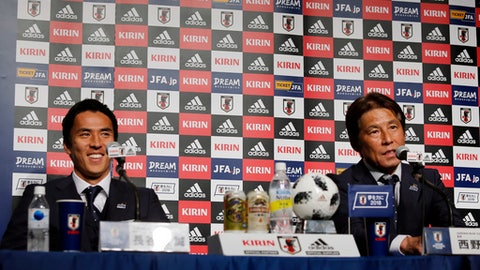 Japanese soccer team coach Akira Nishino, right, speaks as captain Makoto Hasebe smiles during a press conference upon their team's return from the World Cup in Russia, at a hotel in Narita, near Tokyo, Thursday, July 5, 2018. (AP Photo/Shuji Kajiyama)