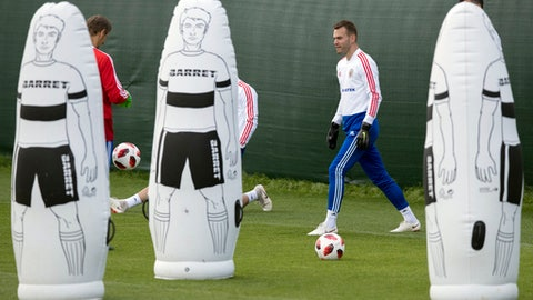 Russia's goalkeeper Igor Akinfeev, right, attends a training session at the 2018 soccer World Cup, at the Federal Sports Centre Novogorsk, near Moscow, Russia, Thursday, July 5, 2018. (AP Photo/Pavel Golovkin)