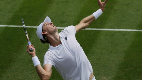 Kevin Anderson of South Africa serves to Andreas Seppi of Italy during their men's singles match on the fourth day at the Wimbledon Tennis Championships in London, Thursday July 5, 2018. (AP Photo/Ben Curtis)
