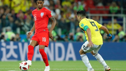 England's Marcus Rashford, left, is challenged by Colombia's Radamel Falcao during the round of 16 match between Colombia and England at the 2018 soccer World Cup in the Spartak Stadium, in Moscow, Russia, Tuesday, July 3, 2018. (AP Photo/Alastair Grant)