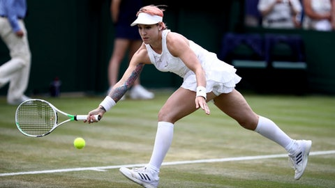 Bethanie Mattek-Sands of the United States in action in a women's doubles match with Lucie Safarova of the Czech Republic, against Kaia Kanepi of Estonia and Andrea Petkovic of Germany, on the fourth day of the Wimbledon Tennis Championships in London, Thursday July 5, 2018. (John Walton/PA  via AP)