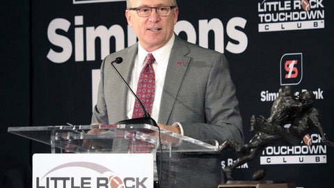 FILE - In this Sept. 11, 2017, file photo, Arkansas athletic director Jeff Long speaks to members of the Little Rock Touchdown Club in Little Rock, Ark. Kansas has hired former Arkansas athletic director Jeff Long to lead its department. Long signed a five-year, fully guaranteed contract that will pay $1.5 million annually. He takes over for Sheahon Zenger, who was fired in May after struggling to turn around the Jayhawks' football program and failing to build support for much-needed stadium renovations.  (AP Photo/Kelly P. Kissel, File)