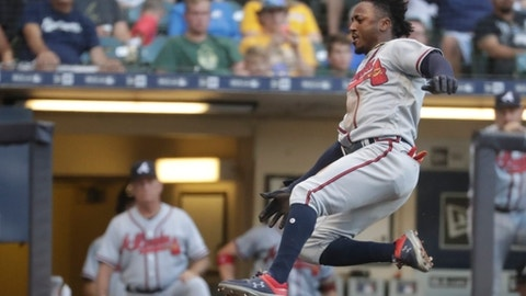 Atlanta Braves' Ozzie Albies slides safely home during the first inning of a baseball game against the Milwaukee Brewers Thursday, July 5, 2018, in Milwaukee. (AP Photo/Morry Gash)