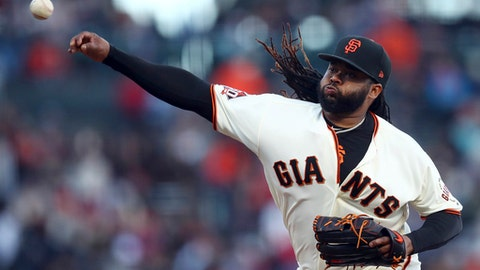 San Francisco Giants pitcher Johnny Cueto works against the St. Louis Cardinals during the first inning of a baseball game Thursday, July 5, 2018, in San Francisco. (AP Photo/Ben Margot)