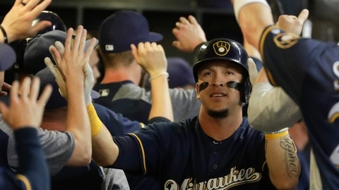 Milwaukee Brewers' Hernan Perez is congratulated after hitting a two-run home run during the eighth inning of a baseball game against the Atlanta Braves Thursday, July 5, 2018, in Milwaukee. (AP Photo/Morry Gash)