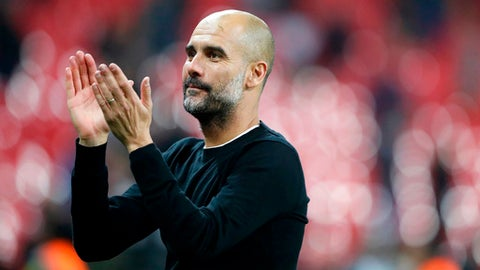 FILE - In this file photo dated Saturday, April 14, 2018, Manchester City manager Pep Guardiola applauds the fans as he walks from the pitch after the end of the English Premier League soccer match against Tottenham Hotspur at Wembley stadium in London. The World Cup triumphs of Spain and Germany in 2010 and '14, respectively, were partly put down to the influence of Pep Guardiola on the club sides _ Barcelona and Bayern Munich _ which made up a significant chunk of those national teams. Could Guardiola be having the same effect on England, too? (AP Photo/Frank Augstein, File)