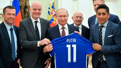 Russian President Vladimir Putin, center, poses for a photo with world soccer legends, former German soccer player Lothar Matthaus, left, FIFA President Gianni Infantino, second left, former Mexican soccer player Jorge Campos Navarrete, right, First Vice President of the Russian Football Union Nikita Simonyan, second right and former Danish soccer player Peter Schmeichel, background, during a meeting in the Kremlin in Moscow, Russia, Friday, July 6, 2018. (Alexei Druzhinin, Sputnik, Kremlin Pool Photo via AP)
