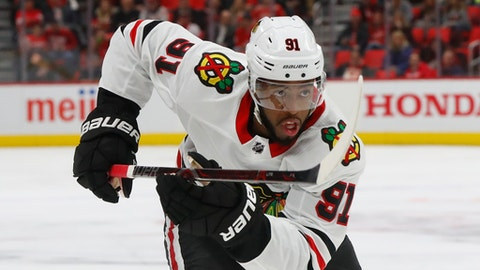FILE - In this Jan. 25, 2018, file photo, Chicago Blackhawks left wing Anthony Duclair (91) plays against the Detroit Red Wings in the first period of an NHL hockey game in Detroit. The Columbus Blue Jackets signed Duclair to a $650,000, one-year contract the NHL veteran minimum, general manager Jarmo Kelakainen announced Friday, July 6, 2018. Duclair remains unfilled potential at 22 after being traded twice and not tendered a qualifying offer as a restricted free agent. (AP Photo/Paul Sancya, File)