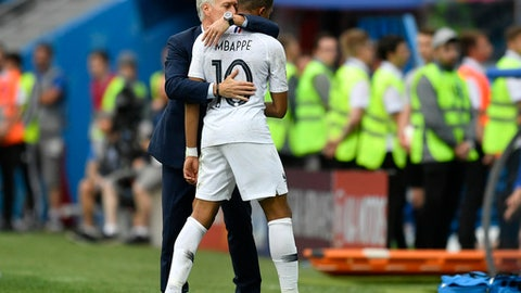 France head coach Didier Deschamps, embraces France's Kylian Mbappe after he was replaced during the quarterfinal match between Uruguay and France at the 2018 soccer World Cup in the Nizhny Novgorod Stadium, in Nizhny Novgorod, Russia, Friday, July 6, 2018. (AP Photo/Martin Meissner)
