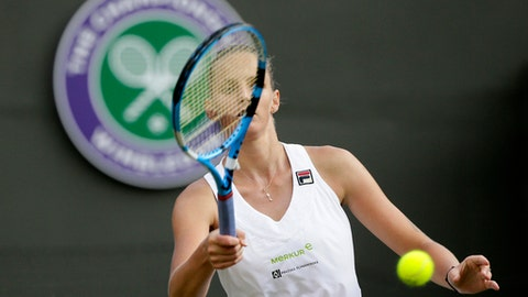 Karolina Pliskova of the Czech Republic prepares to serve to Mihaela Buzarnescu of Romania during their women's singles match on the fifth day at the Wimbledon Tennis Championships in London, Friday July 6, 2018. (AP Photo/Tim Ireland)