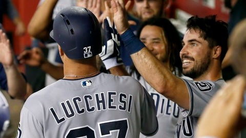 San Diego Padres' Joey Lucchesi (37) celebrates his run scored against the Arizona Diamondbacks with teammates, including Austin Hedges, right, during the third inning of a baseball game Friday, July 6, 2018, in Phoenix. (AP Photo/Ross D. Franklin)