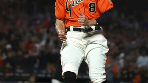 San Francisco Giants' Hunter Pence celebrates after scoring against the St. Louis Cardinals during the seventh inning of a baseball game Friday, July 6, 2018, in San Francisco. (AP Photo/Ben Margot)