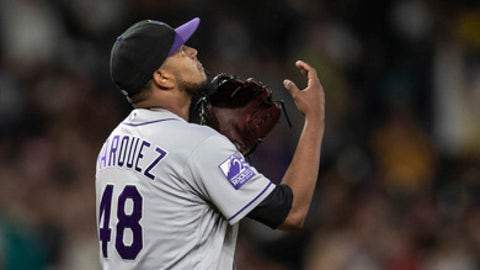 Colorado Rockies starting pitcher German Marquez tosses the ball in the air after giving up a solo home run to Seattle Mariners' Guillermo Heredia during the sixth inning of a baseball game, Friday, July 6, 2018, in Seattle. (AP Photo/Stephen Brashear)
