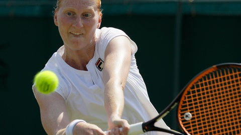 Alison Van Uytvanck of Belgium returns the ball to Anett Kontaveit of Estonia during their women's singles match, on the sixth day of the Wimbledon Tennis Championships in London, Saturday July 7, 2018. (AP Photo/Kirsty Wigglesworth)