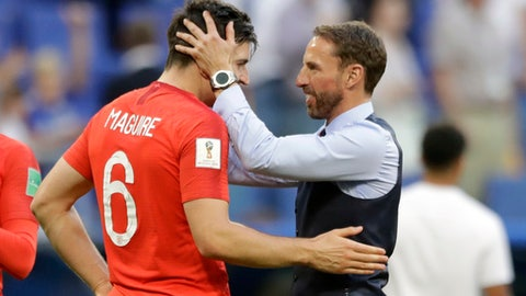 England head coach Gareth Southgate, right, celebrates victory of his team over Sweden with England's Harry Maguire during the quarterfinal match between Sweden and England at the 2018 soccer World Cup in the Samara Arena, in Samara, Russia, Saturday, July 7, 2018. (AP Photo/Matthias Schrader )