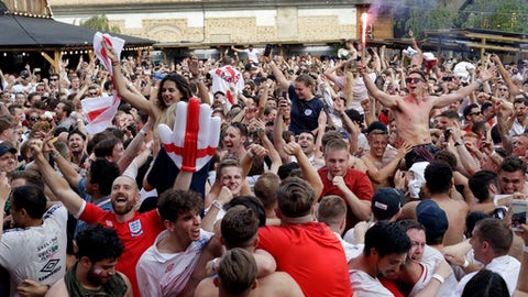 England soccer fans celebrate on the final whistle as they watch a live broadcast on a big screen of the quarterfinal match between England and Sweden at the 2018 soccer World Cup, in Flat Iron Square, south London, Saturday, July 7, 2018. (AP Photo/Matt Dunham)