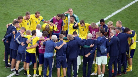 The Swedish team gathers together on the pitch at the end of the quarterfinal match between Sweden and England at the 2018 soccer World Cup in the Samara Arena, in Samara, Russia, Saturday, July 7, 2018. (AP Photo/Thanassis Stavrakis)