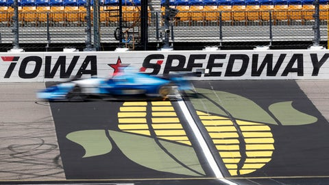 Ed Jones (10) passes the finish line during practice for the IndyCar Series auto race, Saturday, July 7, 2018, at Iowa Speedway in Newton, Iowa. (AP Photo/Charlie Neibergall)