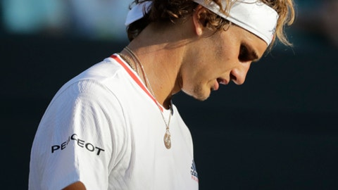 Alexander Zverev of Germany loses a point to Ernests Gulbis of Latvia during their men's singles match on the sixth day at the Wimbledon Tennis Championships in London, Saturday July 7, 2018. (AP Photo/Ben Curtis)