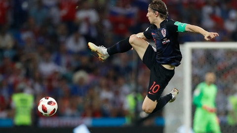 Croatia's Luka Modric jumps for the ball during the quarterfinal match between Russia and Croatia at the 2018 soccer World Cup in the Fisht Stadium, in Sochi, Russia, Saturday, July 7, 2018. (AP Photo/Darko Bandic)